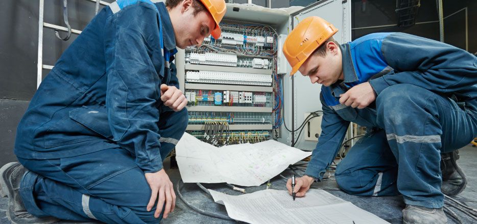 Two Electricians Reviewing Schematic